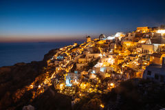 Santorini During Blue Hour. Santorini lighting up just after the sun went down Royalty Free Stock Photos