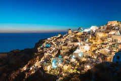 Santorini During Blue Hour. Santorini lighting up just after the sun went down Royalty Free Stock Photo