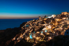 Santorini during blue hour. Santorini lighting up just after the sun went down Stock Photography