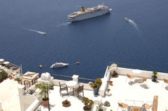 Santorini boats and balconies. View of a cruise ship and smaller boats with balconies in the foreground, Greek Islands, Santorini (Thera Stock Image