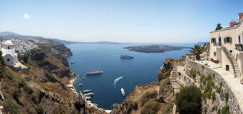 Santorini caldera Panorama. A panoramic image from Santorini of the villages of Fira and Firastefani with a view of the caldera in between them royalty free stock photography