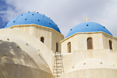 Santorini chapel. A Greek church/chapel with two blue domes in Parissa on the island of Santorini, Greece Stock Image
