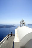 Picturesque Orthodox church at Santorini, Greece. Picturesque Orthodox church at Imerovigli and great view of Caldera, Santorini Island - Greece Royalty Free Stock Image