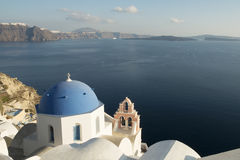 Santorini church. The blue dome of a church at Oia on the island of Santorini in the Agean Sea with a view of the caldera royalty free stock images
