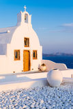 Santorini church and roof and caldera at sunset Stock Images