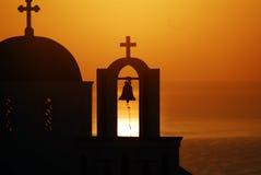 Santorini church sunrise II. Santorini sunrise by the church bell Royalty Free Stock Photo