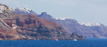 Santorini - cliffs of calera with the cruises withe the Imerovigli and Skaros Stock Image