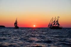 Sailing ships. Santorini Coast sailing ships in the sunset stock photos
