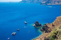 Island Santorini, Crete, Greece : White cruise boats ships on background blue sea. Top view royalty free stock images
