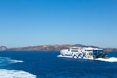 Santorini, Crete: White Ferry  boat  seajets cruise in Crete in sea on background mountains. Nearly island royalty free stock image