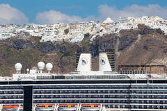 Santorini - The cruise and Fira town in the background. Royalty Free Stock Images