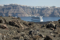 Santorini cruise ship. A cruise ship moored in the caldera at Santorini, Greece with Santorini`s capital Thira sitting on cliffs in the background Stock Photo