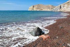 Santorini - der rote Strand Stockfotografie