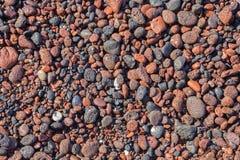 Santorini - dettaglio di pomice dalla spiaggia rossa Immagine Stock