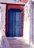 Santorini door. Old blue door conceals a mystery Royalty Free Stock Photo
