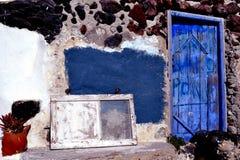 Santorini, door. Two old door in a stone wall Royalty Free Stock Image