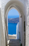 Santorini doorway. The view through an arched doorway in Santorini, Greece Royalty Free Stock Photography