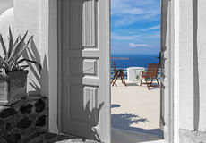 Santorini - The easy table and easy charis over the caldera. Stock Photography