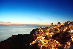 Santorini in the evening, Oia village with windmil royalty free stock images