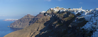 Santorini - The Fira and Firostefani in morning light and the Scaros castle, Imerovigli and Oia in background. Stock Photography