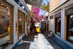 SANTORINI,FIRA-JULY 28: Narrow shopping street on July 28,2014 in Fira town on the Santorini island in Greece. Royalty Free Stock Photos