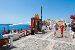 SANTORINI,FIRA-JULY 28:Tourists enjoy view next to Fira Cathedral on July 28,2014 in Fira town on the Santorini island, Greece. Stock Photography