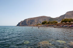 SANTORINI,FIRA-JULY 28: Tourists sunbathe on the Kamari Beach on July 28,2014. Santorini(Thira), Greece. Stock Photos