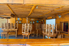SANTORINI,FIRA-JULY 28: Wooden bar on July 28,2014 in Fira town on the Santorini island, Greece. Stock Photos