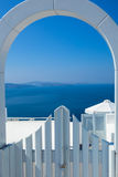 Santorini Gate and Ocean. White Gate Overlooking Aegean Sea royalty free stock images