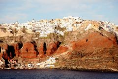 Santorini, Greece from the Aegean Sea. Looking back at the island of Santorini, Greece, from the mile-deep waters of the rich blue Aegean Sea. Photo taken Royalty Free Stock Image