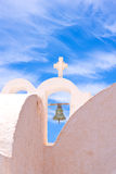 Santorini Greece Church with bells and cross against blue sky Stock Images