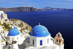 Santorini, Greece Churches. Whitewashed walls contrast the blue sky and blue church domes in the town of Oia on the island of Santorini, Greece Stock Image
