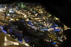 Santorini, Greece. Fira town, Oia vilage night view. A beautiful, romantic place, resulted from a super volcano eruption in Aegean. Sea royalty free stock images