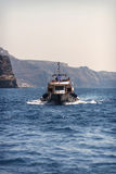 SANTORINI, GREECE - JUNE 30: Touristic ships in the harbor on Ju Stock Image