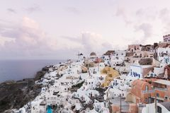 SANTORINI, GREECE - MAY 2018: Iconic panoramic view over Oia village on Santorini island, Greece. Shot taken at sunrise stock photos