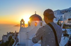 A young man enjoying on Santorini Island stock photo