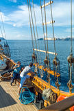 Santorini. Greece - October 13, 2012:  People on a Brigantine in navigation in the Caldera sea area Royalty Free Stock Photography