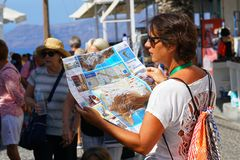 Santorini, Greece, September 21 2018, A tourist looks at a map. In Thira royalty free stock photo