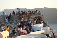 Santorini, Greece, September 20 2018 Tourists waiting to see the sunset in Oia royalty free stock photos