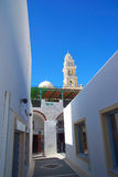 Santorini, Greece street with building at bell tower with clock Stock Images
