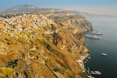Santorini, Greece: sunset view of Fira over the volcano cliffs Royalty Free Stock Images