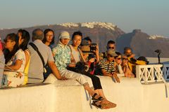 Santorini, Greece 19 2018, tourists from all over the world wait for the sunset in the town of Oia stock photo