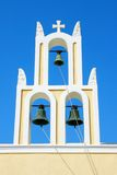 Santorini, Greece: traditional typical orthodox church with thre Royalty Free Stock Photo