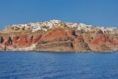 Santorini, Greece: view of Oia village over the the volcano cliffs Royalty Free Stock Images