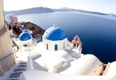 Santorini greek island blue dome churches. Blue dome churches and classic cyclades architecture over the mediterranean sea in oia santorini the famous greek stock image