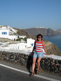 Santorini greek islands hotel traditional hou. Middle age female lady tourist smiling romantic hotel view traditional house with volcanic cliff caldera view royalty free stock photos