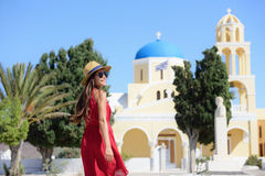Santorini happy tourist woman at blue dome church Stock Photo