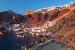 Santorini - The harbor of Oia in evening light. Royalty Free Stock Photography