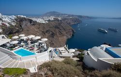 Santorini infinity pool detail on Fira and Oia town in summer traveling time. Santorini architectural detail and panoramic view on Fira and Oia town in summer stock photography