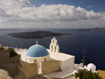 Santorini Island. Magical view of the church, the sea and the adjacent islands from the terrace of the house on Santorini, Greece stock photos